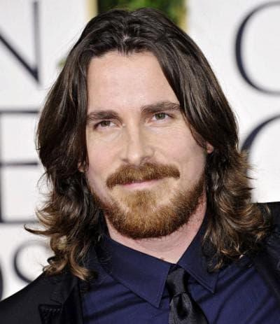 симметричная мужская прическа на длинные волосы