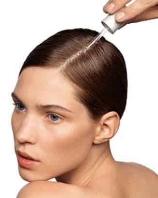 нанесение минокосола на волосы